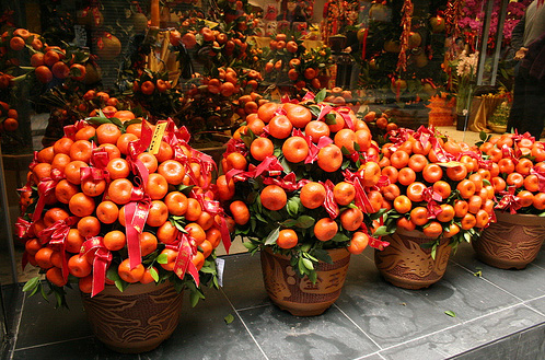 Mandarins in front of a store